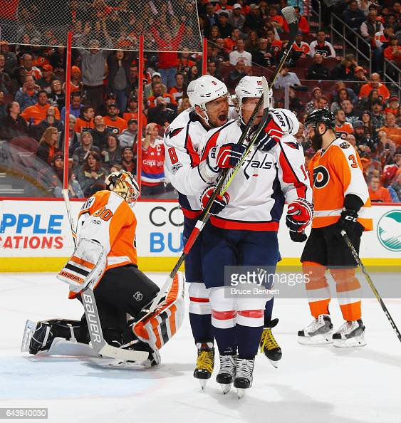 Alex Ovechkin congratulates Nicklas Backstrom of the Washington Capitals on his goal at 633 of the first period against Michal Neuvirth of the...