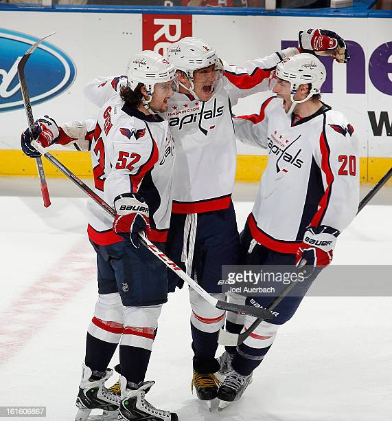 Alex Ovechkin is congratulate by Mike Green and Troy Brouwer of the Washington Capitals after he scored a goal in the third period to tie the game...