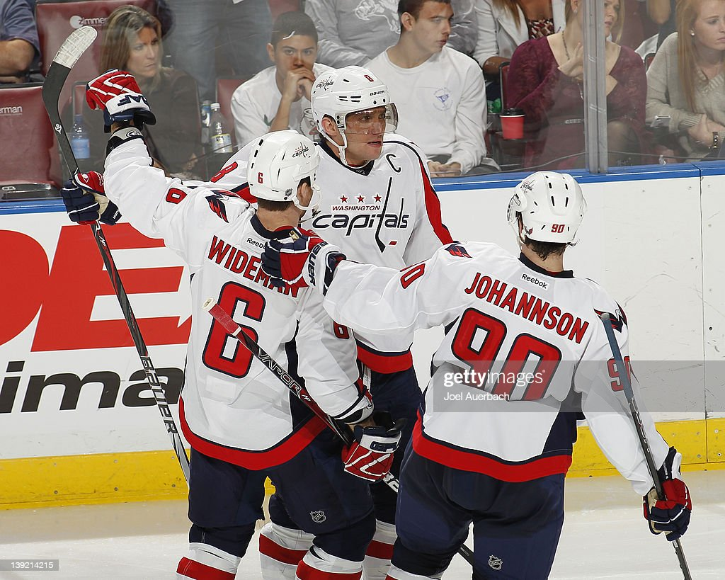Alex Ovechkin #8 is congratulated by <a gi-track='captionPersonalityLinkClicked' href=/galleries/search?phrase=Dennis+Wideman&family=editorial&specificpeople=575234 ng-click='$event.stopPropagation()'>Dennis Wideman</a> #6 and <a gi-track='captionPersonalityLinkClicked' href=/galleries/search?phrase=Marcus+Johansson&family=editorial&specificpeople=4247883 ng-click='$event.stopPropagation()'>Marcus Johansson</a> #90 of the Washington Capitals after scoring a third period goal against the Florida Panthers on February 17, 2012 at the BankAtlantic Center in Sunrise, Florida. The Capitals defeated the Panthers 2-1.