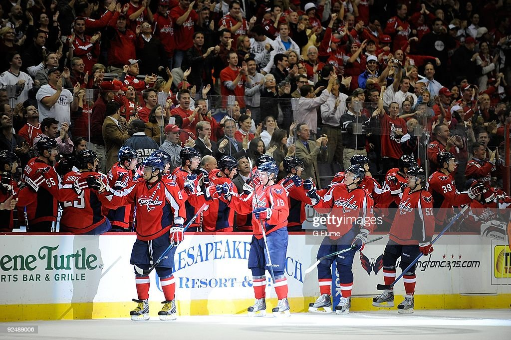 Alex Ovechkin Nicklas Backstrom Alexander Semin and Mike Green of the Washington Capitals celebrate with teammates after scoring against the...