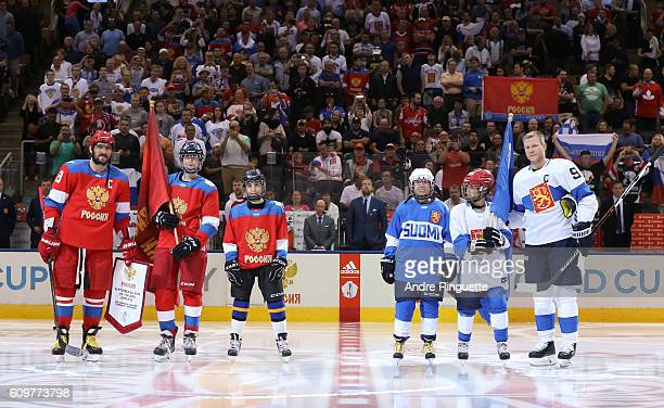 Alex Ovechkin of Team Russia exchanges team flags with Mikko Koivu of Team Finland during the World Cup of Hockey 2016 at Air Canada Centre on...