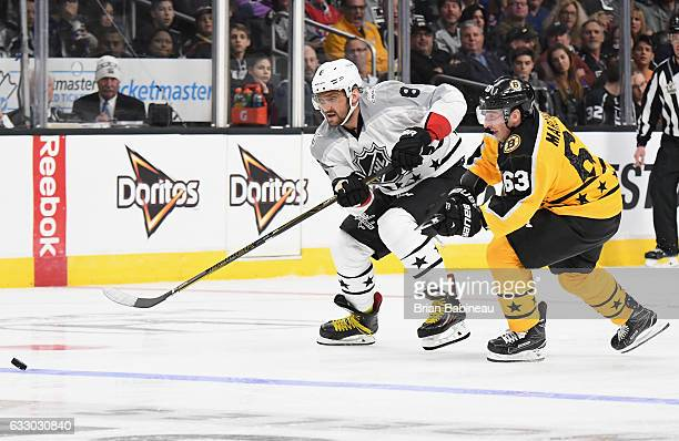 Alex Ovechkin of the Washington Capitals and Brad Marchand of the Boston Bruins pursue the puck during the Metropolitan Division and Atlantic...