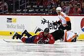 Alex Ovechkin of the Washington Capitals and Brayden Schenn of the Philadelphia Flyers go after the puck in the second period of Game Five of the...