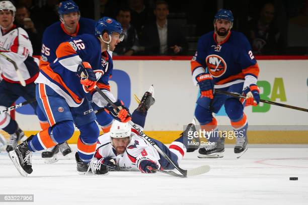 Alex Ovechkin of the Washington Capitals and Josh Bailey of the New York Islanders pursue the puck at the Barclays Center on January 31 2017 in...