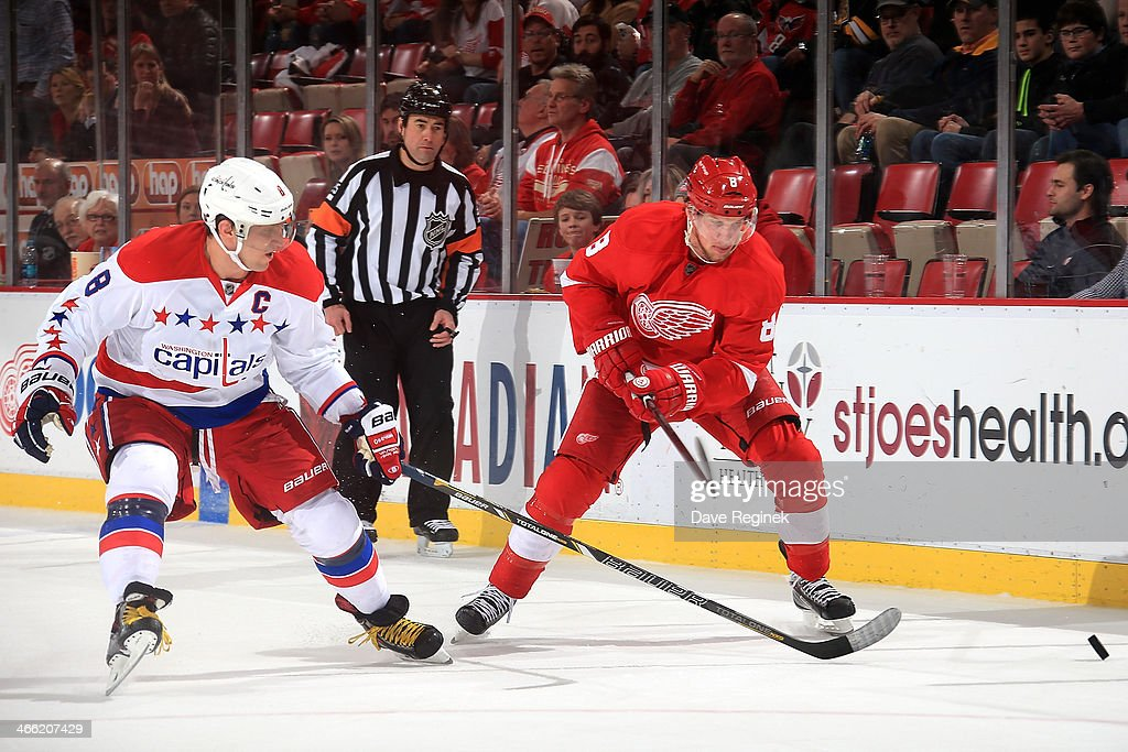 Alex Ovechkin #8 of the Washington Capitals and <a gi-track='captionPersonalityLinkClicked' href=/galleries/search?phrase=Justin+Abdelkader&family=editorial&specificpeople=2271858 ng-click='$event.stopPropagation()'>Justin Abdelkader</a> #8 of the Detroit Red Wings fight for the puck during an NHL game on January 31, 2014 at Joe Louis Arena in Detroit, Michigan. Detroit defeated Washington 4-3 in a shootout.