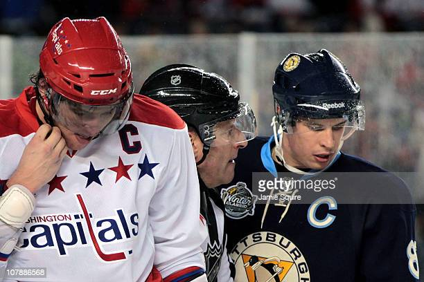 Alex Ovechkin of the Washington Capitals and Sidney Crosby of the Pittsburgh Penguins are seperated by a referee during the 2011 NHL Bridgestone...
