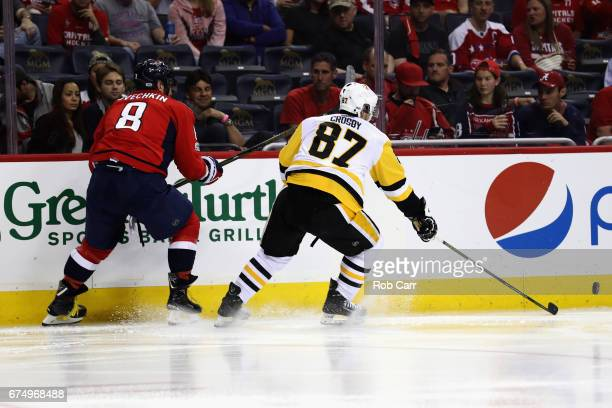 Alex Ovechkin of the Washington Capitals and Sidney Crosby of the Pittsburgh Penguins skate after the puck in Game Two of the Eastern Conference...