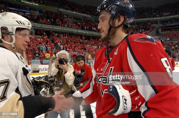 Alex Ovechkin of the Washington Capitals and Sidney Crosby of the Pittsburgh Penguins shake hands at the end of the game at the Verizon Center during...