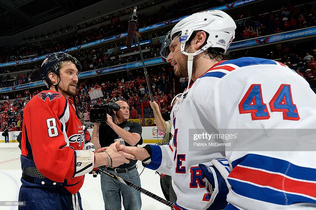 Alex Ovechkin of the Washington Capitals and Steve Eminger of the New York Rangers shake hands after Game Seven of the Eastern Conference...