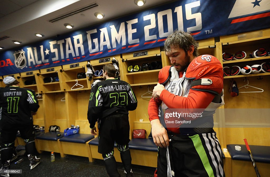 Alex Ovechkin #8 of the Washington Capitals and Team Foligno gets ready in the locker room before playing in the 2015 Honda NHL All-Star Game at Nationwide Arena on January 25, 2015 in Columbus, Ohio.