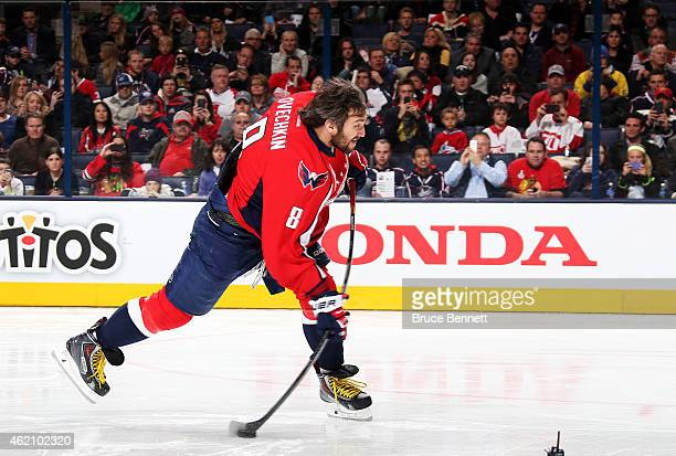 Alex Ovechkin of the Washington Capitals and Team Foligno takes a shot during the AMP NHL Hardest Shot event of the 2015 Honda NHL AllStar Skills...