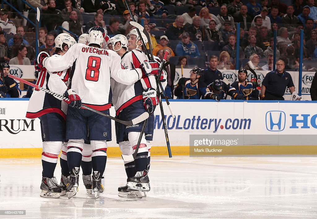 Alex Ovechkin #8 of the Washington Capitals and teammates celebrate a goal against the St. Louis Blues during an NHL game on April 8, 2014 at Scottrade Center in St. Louis, Missouri.