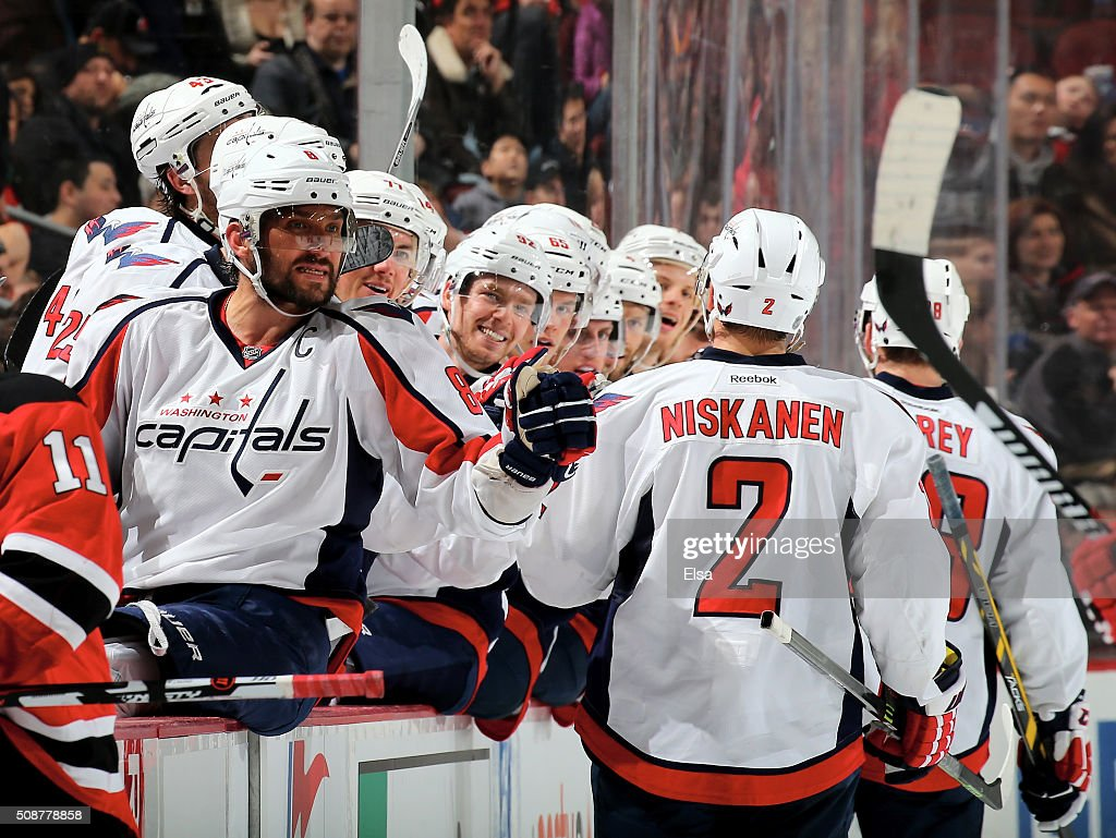 Alex Ovechkin #8 of the Washington Capitals and the rest of the bench celebrates teammate Paul Carey's goal in the third period against the New Jersey Devils on February 6, 2016 at Prudential Center in Newark, New Jersey.The Washington Capitals defeated the New Jersey Devils 3-2 in an overtime shootout.