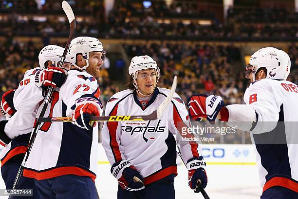 Alex Ovechkin of the Washington Capitals and TJ Oshie congratulate Karl Alzner after he scored against the Boston Bruins during the second period at...