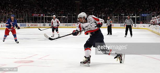 Alex Ovechkin of the Washington Capitals attempts a shot on goal against the New York Rangers in Game Two of the Eastern Conference Semifinals during...