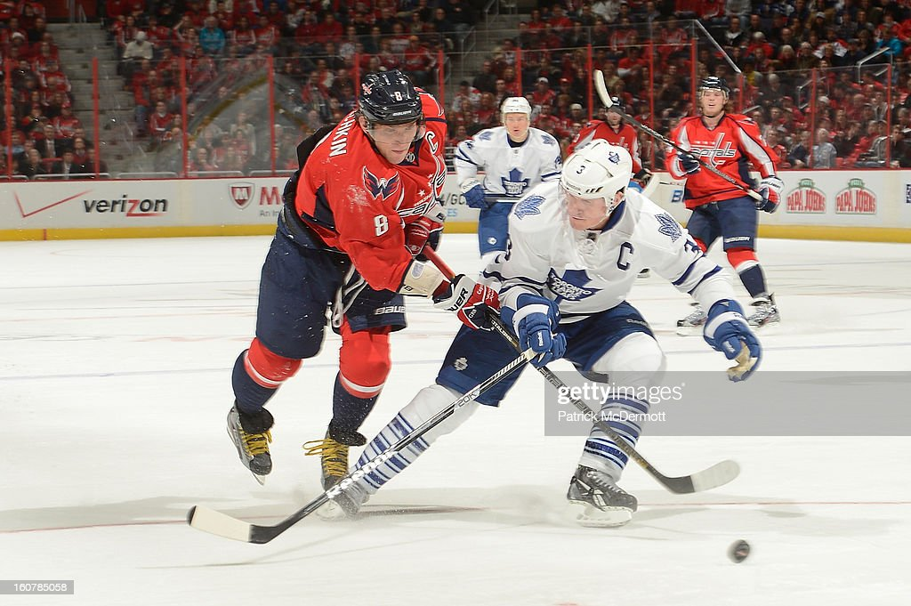 Alex Ovechkin #8 of the Washington Capitals attempts to get a shot off against <a gi-track='captionPersonalityLinkClicked' href=/galleries/search?phrase=Dion+Phaneuf&family=editorial&specificpeople=545455 ng-click='$event.stopPropagation()'>Dion Phaneuf</a> #3 of the Toronto Maple Leafs during the third period of an NHL game at Verizon Center on February 5, 2013 in Washington, DC.