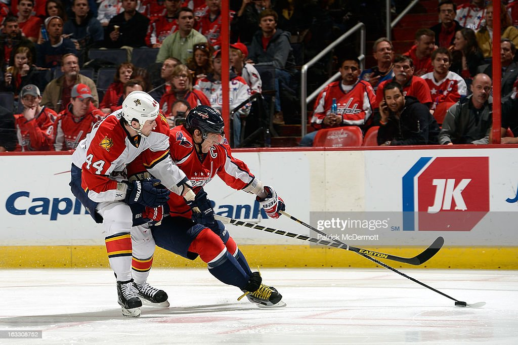 Alex Ovechkin #8 of the Washington Capitals battles for the puck against <a gi-track='captionPersonalityLinkClicked' href=/galleries/search?phrase=Erik+Gudbranson&family=editorial&specificpeople=5741800 ng-click='$event.stopPropagation()'>Erik Gudbranson</a> #44 of the Florida Panthers during the third period of an NHL game at Verizon Center on March 7, 2013 in Washington, DC.