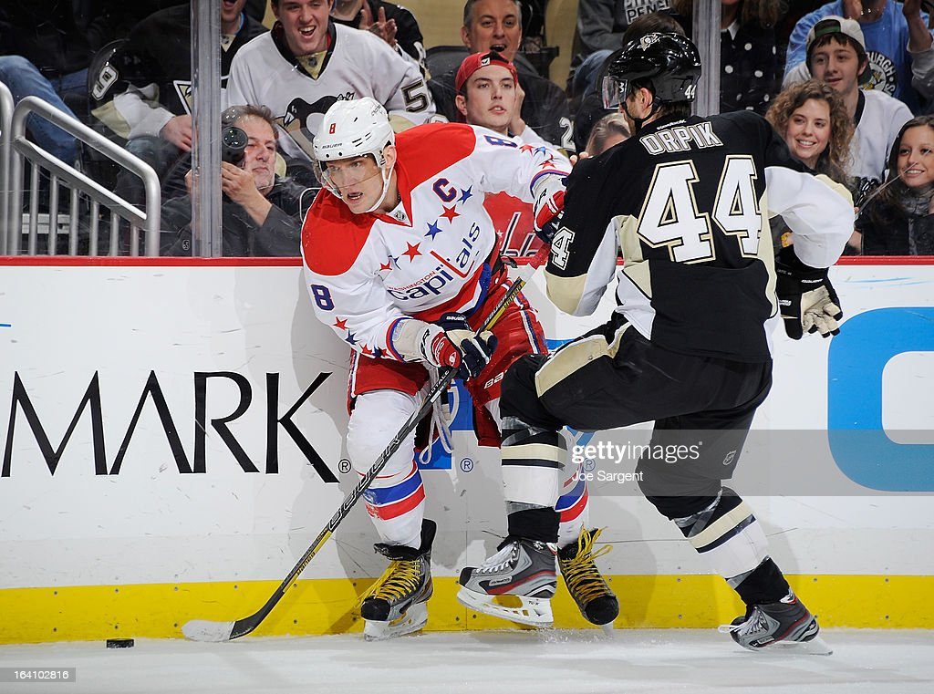 Alex Ovechkin #8 of the Washington Capitals battles for the puck against Brooks Orpik #44 of the Pittsburgh Penguins on March 19, 2013 at Consol Energy Center in Pittsburgh, Pennsylvania.