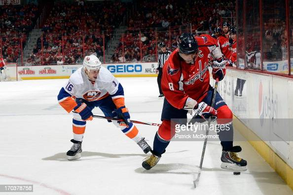 Alex Ovechkin of the Washington Capitals battles for the puck against Marty Reasoner of the New York Islanders during an NHL game at Verizon Center...