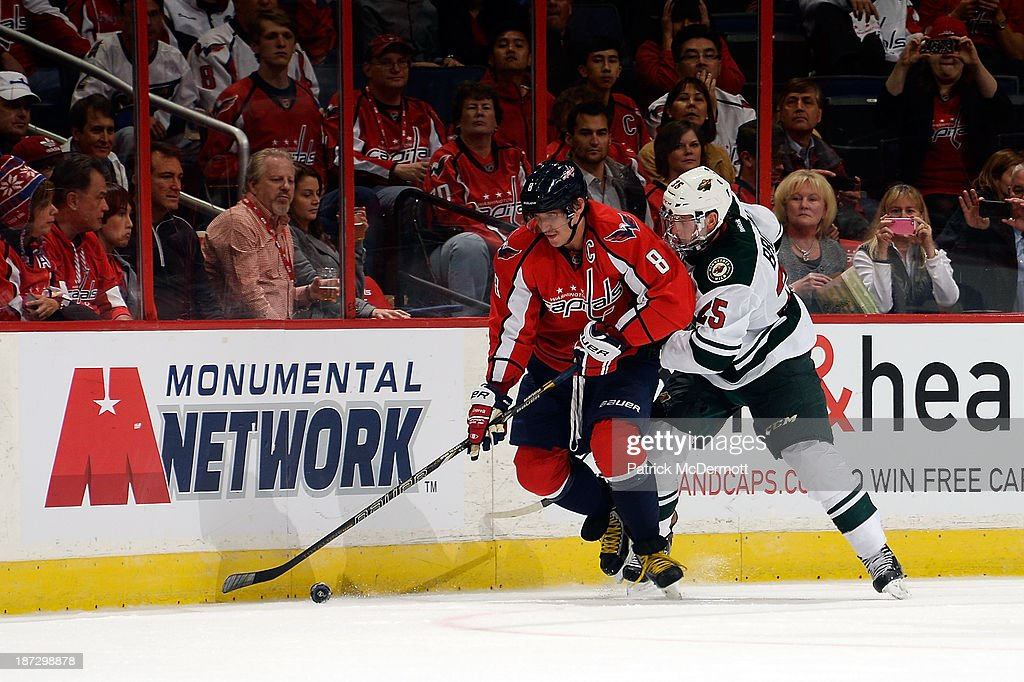 Alex Ovechkin #8 of the Washington Capitals battles for the puck against <a gi-track='captionPersonalityLinkClicked' href=/galleries/search?phrase=Jonas+Brodin&family=editorial&specificpeople=7832272 ng-click='$event.stopPropagation()'>Jonas Brodin</a> #25 of the Minnesota Wild in the third period of an NHL game at Verizon Center on November 7, 2013 in Washington, DC.