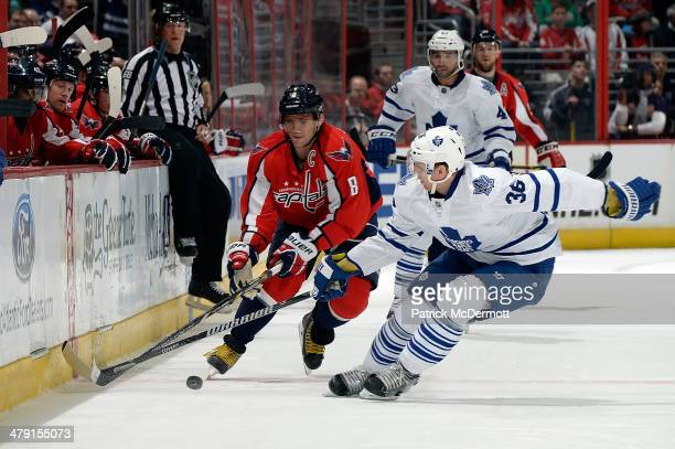 Alex Ovechkin of the Washington Capitals battles for the puck against Carl Gunnarsson of the Toronto Maple Leafs in the third period during an NHL...