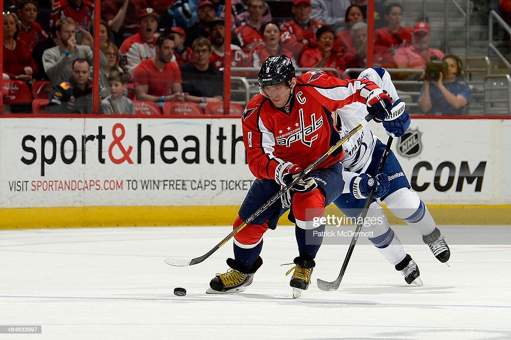 Alex Ovechkin #8 of the Washington Capitals brings the puck up ice in the second period during an NHL game against the Tampa Bay Lightning at Verizon Center on April 13, 2014 in Washington, DC.
