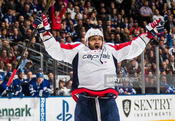 Alex Ovechkin of the Washington Capitals celebrates a goal against the Toronto Maple Leafs scored by his teammate Kevin Shattenkirk during the second...