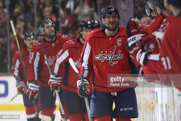 Alex Ovechkin of the Washington Capitals celebrates a goal against the Chicago Blackhawks with Braden Holtby during the first period at Capital One...