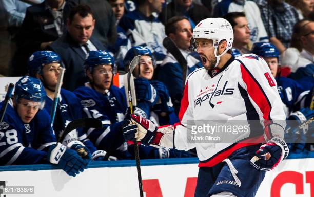 Alex Ovechkin of the Washington Capitals celebrates a goal by his teammate TJ Oshie in front of the Toronto Maple Leafs bench during the first period...