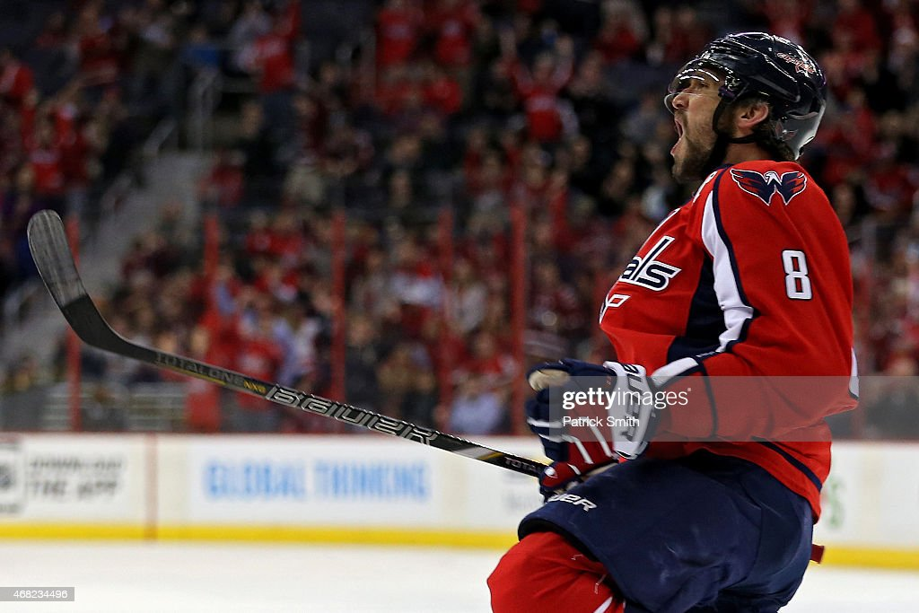 Alex Ovechkin #8 of the Washington Capitals celebrates after scoring a goal against the Carolina Hurricanes in the first period at Verizon Center on March 31, 2015 in Washington, DC.