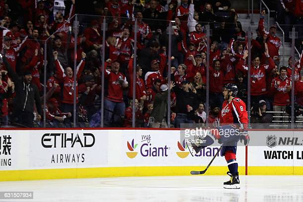 Alex Ovechkin of the Washington Capitals celebrates after scoring a goal for his 1000th career point against the Pittsburgh Penguins in the first...