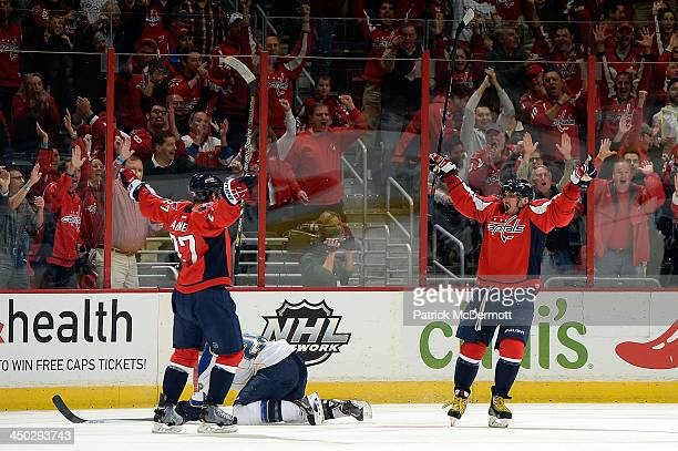 Alex Ovechkin of the Washington Capitals celebrates after scoring his second goal of the game in the first period of an NHL game against the St Louis...