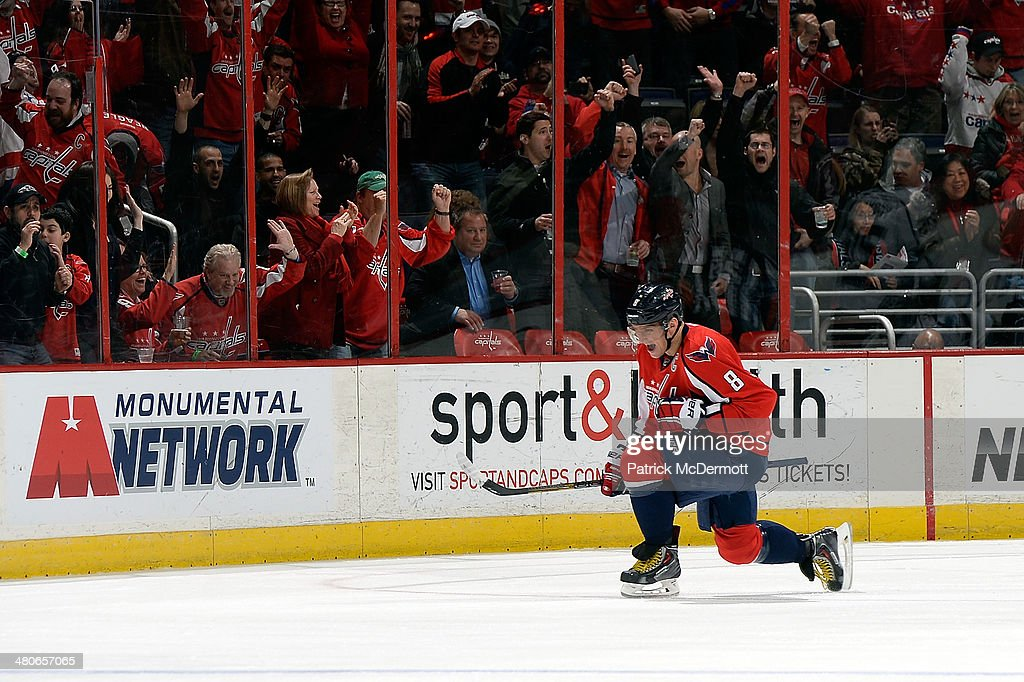 Alex Ovechkin #8 of the Washington Capitals celebrates after scoring his second goal of the game in the first period during an NHL game against the Los Angeles Kings at Verizon Center on March 25, 2014 in Washington, DC.