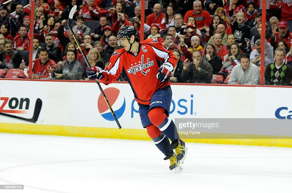 Alex Ovechkin of the Washington Capitals celebrates after scoring the game winning goal in overtime against the Detroit Red Wings at Verizon Center...