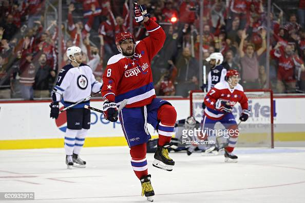 Alex Ovechkin of the Washington Capitals celebrates after scoring the gamewinning goal against the Winnipeg Jets during overtime at Verizon Center on...