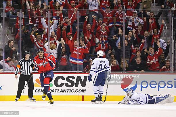 Alex Ovechkin of the Washington Capitals celebrates after scoring the game winning goal in overtime on Frederik Andersen of the Toronto Maple Leafs...