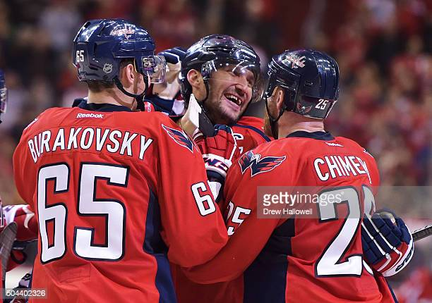 Alex Ovechkin of the Washington Capitals celebrates his 500th career NHL goal in the second period with teammates Andre Burakovsky and Jason Chimera...