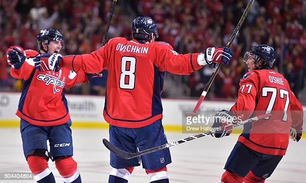 Alex Ovechkin of the Washington Capitals celebrates his 500th career NHL goal in the second period with teammates Matt Niskanen and TJ Oshie against...