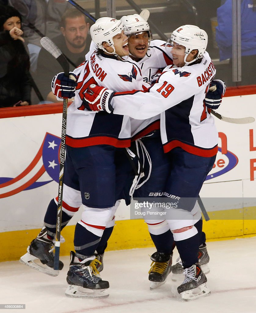 Alex Ovechkin of the Washington Capitals celebrates his game winning goal with John Carlson and Nicklas Backstrom of the Washington Capitals in the...