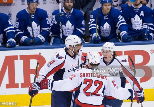 Alex Ovechkin of the Washington Capitals celebrates his goal against the Toronto Maple Leafs with teammates Kevin Shattenkirk and TJ Oshie during the...