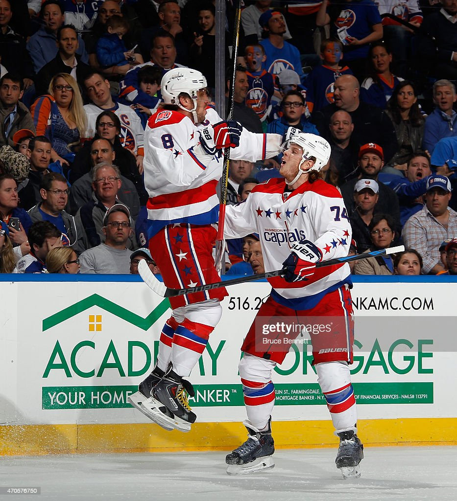 Alex Ovechkin #8 of the Washington Capitals celebrates his goal at 13:06 of the first period against the New York Islanders and is joined by John Carlson #74 in Game Four of the Eastern Conference Quarterfinals during the 2015 NHL Stanley Cup Playoffs at Nassau Veterans Memorial Coliseum on April 21, 2015 in Uniondale, New York.