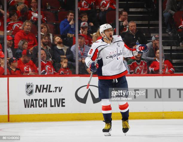Alex Ovechkin of the Washington Capitals celebrates his power play goal at 801 of the second period against the New Jersey Devils at the Prudential...