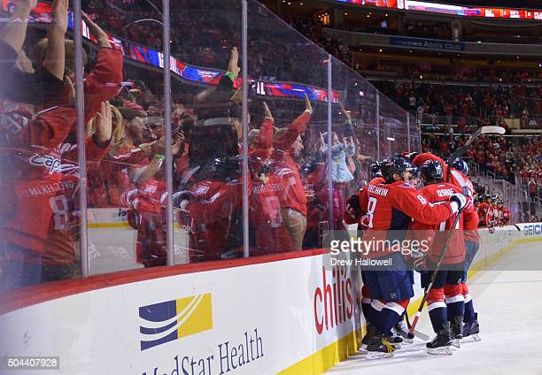 Alex Ovechkin of the Washington Capitals celebrates his second goal of the game with his teammates during the game against the Ottawa Senators at the...