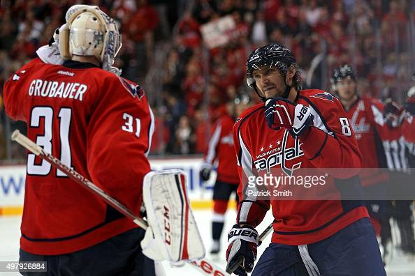Alex Ovechkin of the Washington Capitals celebrates his third period goal with goalie Philipp Grubauer against the Dallas Stars at Verizon Center on...