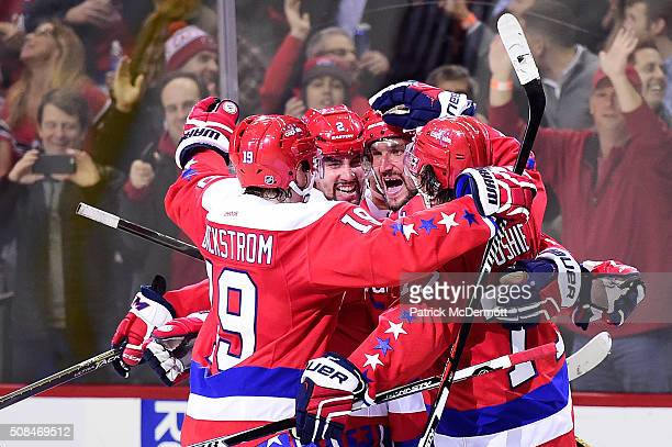 Alex Ovechkin of the Washington Capitals celebrates his third period goal with his teammates during their game against the New York Islanders at...