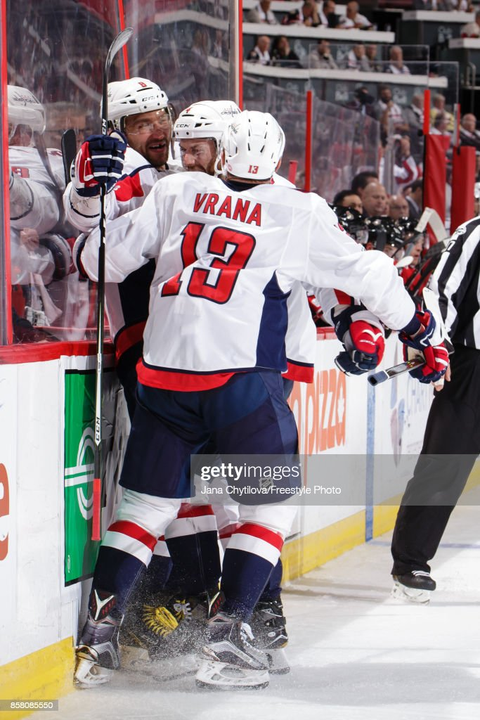 Alex Ovechkin #8 of the Washington Capitals celebrates his third period goal and third of the game for a hattrick against the Ottawa Senators with teammates Jakub Vrana #13 and Taylor Chorney #4 at Canadian Tire Centre on October 5, 2017 in Ottawa, Ontario, Canada.
