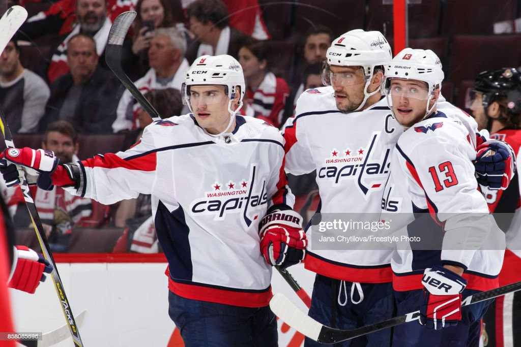 Alex Ovechkin #8 of the Washington Capitals celebrates his third period goal against the Ottawa Senators with teammates Dmitry Orlov #9 and Jakub Vrana #13 at Canadian Tire Centre on October 5, 2017 in Ottawa, Ontario, Canada.