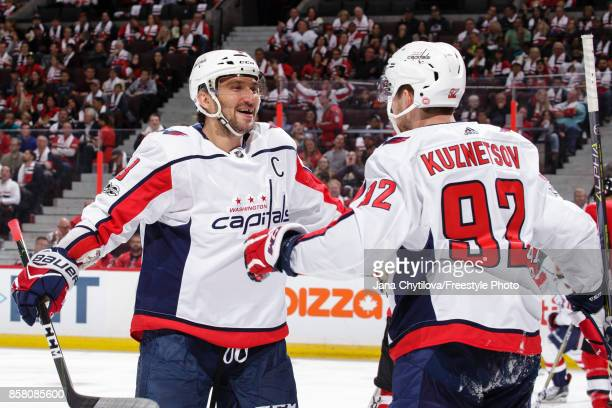 Alex Ovechkin of the Washington Capitals celebrates his third period goal and second of the game against the Ottawa Senators with teammate Evgeny...