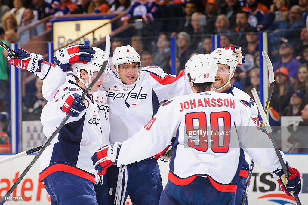 Alex Ovechkin #8 of the Washington Capitals celebrates scoring the Capitals' first goal against the Edmonton Oilers along with his teammates Marcus Johansson #90 and Karl Alzner #27 during an NHL game at Rexall Place on October 24, 2013 in Edmonton, Alberta, Canada. The Capitals defeated the Oilers 4-1.