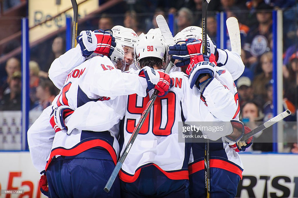 Alex Ovechkin #8 of the Washington Capitals celebrates scoring the Capitals' first goal against the Edmonton Oilers along with his teammates John Carlson #74 and Marcus Johansson #90 during an NHL game at Rexall Place on October 24, 2013 in Edmonton, Alberta, Canada. The Capitals defeated the Oilers 4-1.